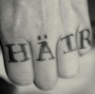 Knuckle tattoo, hair, german black inscription