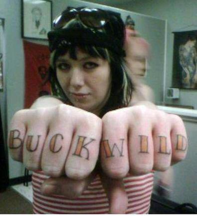Knuckle tattoo, buck wild, styled inscription
