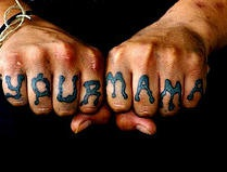 Knuckle tattoo,mama, blue, flowing letters
