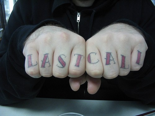 Knuckle tattoo, last call, red styled inscription