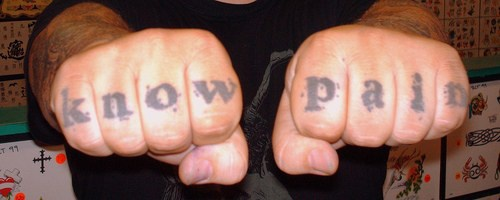 Knuckle tattoo, black inscription, know pain