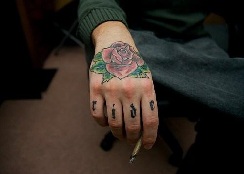 Knuckle tattoo, ride, beautiful colourful rose