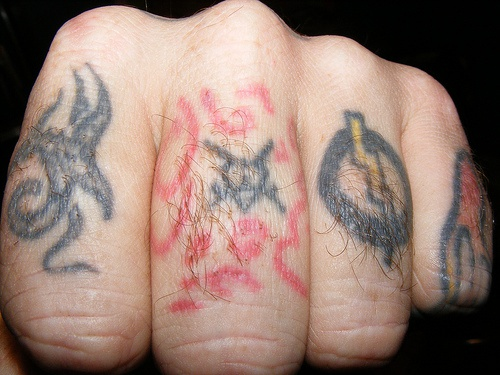 Knuckle tattoo, four colourful, different images