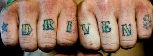 Knuckle tattoo, driven, decorated with star, flower