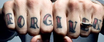 Knuckle tattoo, forgiven, dark styled inscription