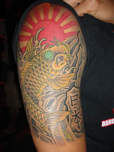 Golden third eye koi and sunrise tattoo