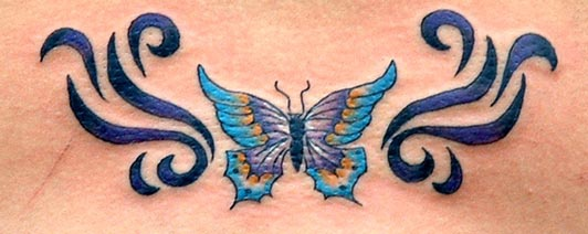 Colourful tribal butterfly tattoo