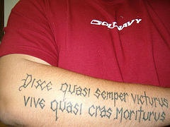Middle age style latin writings tattoo