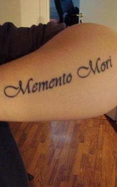 Memento mori arm tattoo
