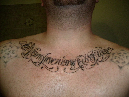 Latin lettering tattoo on chest for Latin tattoo fonts