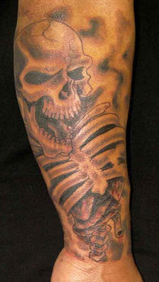 Laughing skeleton tattoo on leg