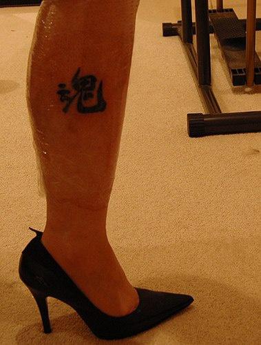 Leg tattoo, one beautiful black hieroglyph
