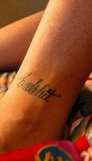 Leg tattoo, badshit, refined, thin inscription