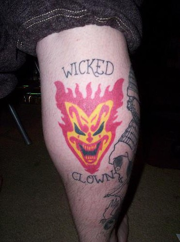 Leg tattoo,firing laughing wicked clown