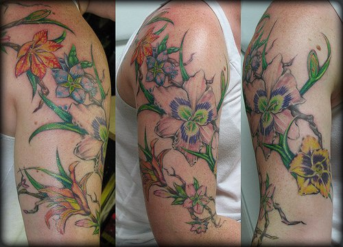 Bunch of flower blossom coloured tattoo