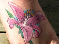 Pink lily flower tattoo