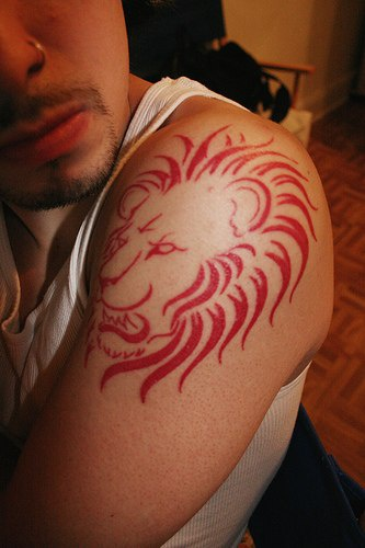 Lion head red ink tattoo for Red ink tattoos