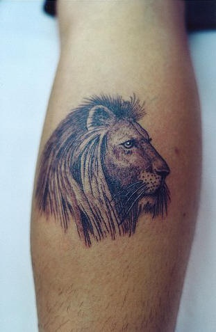Lion head black ink tattoo on forearm