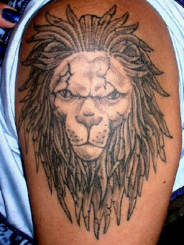 Dreadlock lion head tattoo