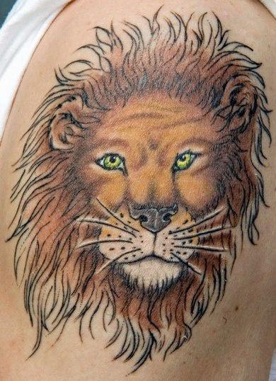 Colourful lion head tattoo