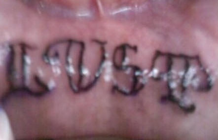 Lip tattoo, lust, volumetric styled inscription