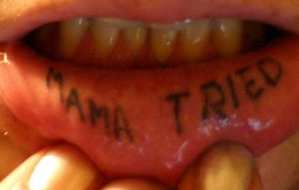 Lip tattoo, mama tried, simple styled inscription