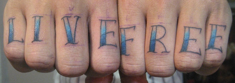 Knuckle tattoo, live free, blue styled inscription