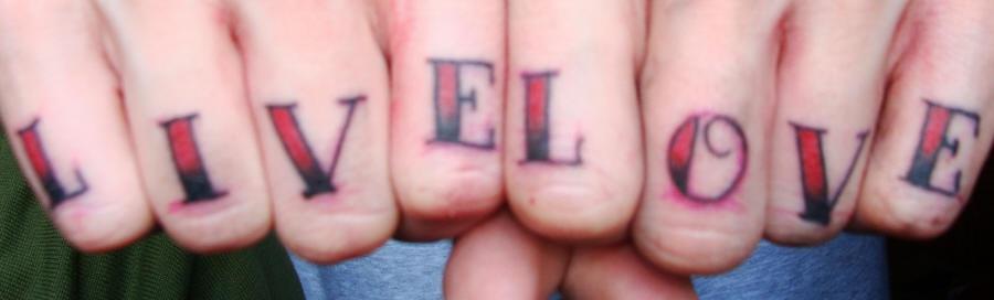 Knuckle tattoo,live love, red designed inscription