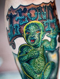 Lizard skin kid coloured tattoo