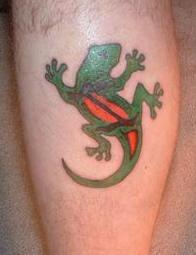 Green and orange lizard tattoo