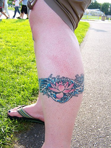 Tender pink lotus in waters tattoo