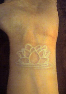 Lotus flower white ink tattoo on wrist for White lotus tattoo
