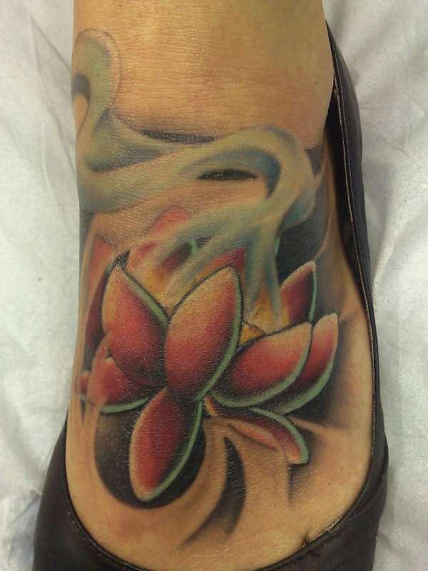 Lotus flower coloured tattoo on foot