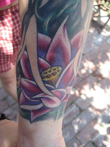 Pink lotus part of  tattoo