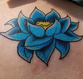 Blue and yellow lotus flower tattoo