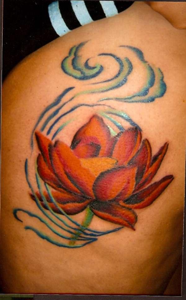 Orange lotus in wind tattoo