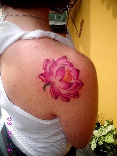 Pink lotus tattoo on shoulder