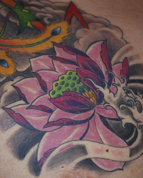 Pink lotus flower in black waters tattoo