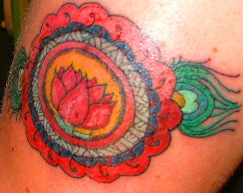 Sacred red lotus flower tattoo