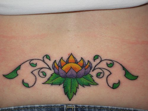 Purple lotus tracery tattoo on lower back