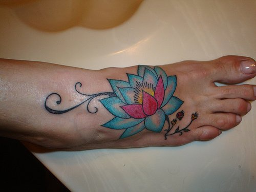 Pale blue lotus tattoo on foot