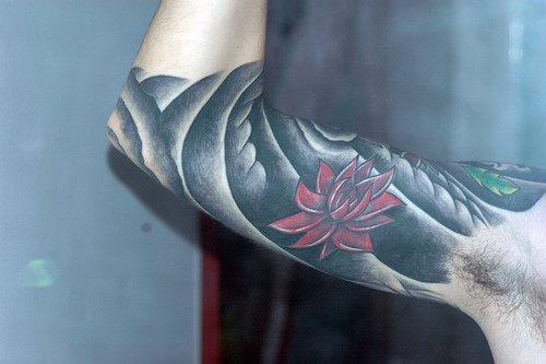 Lotus flower on black background tattoo