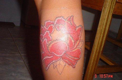 Lush pink lotus flower tattoo