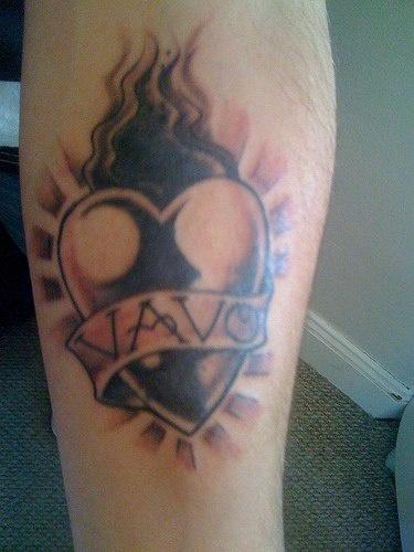 Sacred heart with name vevo tattoo
