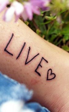 Live and heart symbol tattoo