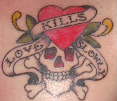 Love kills slowly with heart and skull tattoo