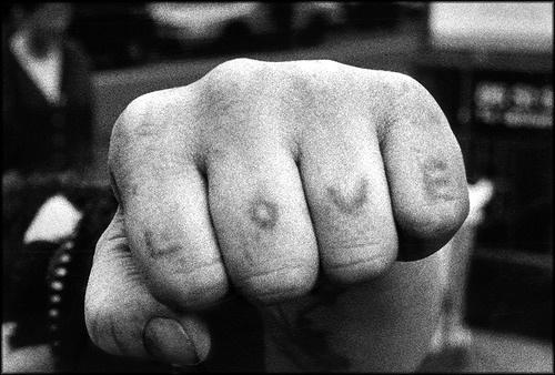 Love text tattoo on knuckle