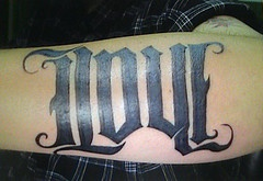 Love black ink lettering tattoo