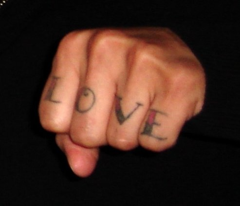 Love word tattoo on knuckle