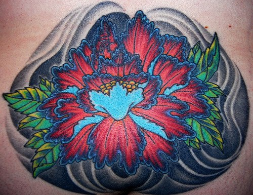 Lower back tattoo, very bright, charming, red and blue flower
